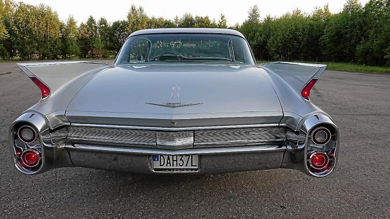 Cadillac six window