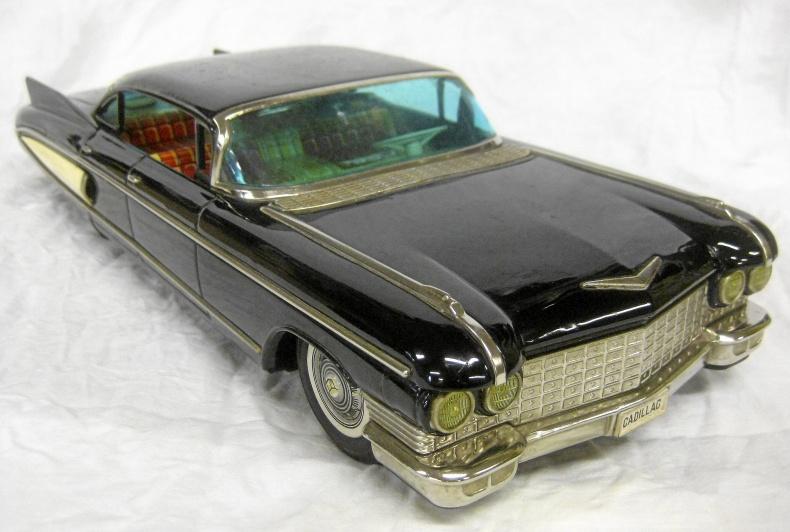 Cadillac 1960 plåtbil friktionsdrift