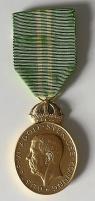 Medalj i guld - fotbolls VM 1958